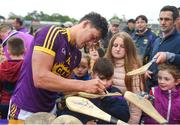 20 May 2018; Lee Chin of Wexford signs hurls after the Leinster GAA Hurling Senior Championship Round 2 match between Wexford and Dublin at Innovate Wexford Park in Wexford. Photo by Daire Brennan/Sportsfile