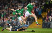 20 May 2018; Barry Murphy of Limerick leaps over Tipperary goalkeeper Brian Hogan as he celebrates scoring a late goal during the Munster GAA Hurling Senior Championship Round 1 match between Limerick and Tipperary at the Gaelic Grounds in Limerick. Photo by Ray McManus/Sportsfile