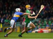 20 May 2018; Cathal O'Neill of Limerick in action against Johnny Ryan of Tipperary during the Electric Ireland Munster GAA Hurling Minor Championship Round 1 match between Limerick and Tipperary at the Gaelic Grounds in Limerick. Photo by Ray McManus/Sportsfile