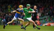 20 May 2018; Emmet McEvoy of Limerick in action against Conor O'Dwyer of Tipperary during the Electric Ireland Munster GAA Hurling Minor Championship Round 1 match between Limerick and Tipperary at the Gaelic Grounds in Limerick. Photo by Ray McManus/Sportsfile