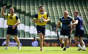 25 May 2018; Ross Byrne, centre, along with team mates, from left, James Tracy, Dan Leavy and Jordan Larmour during the Leinster captains run at the Aviva Stadium in Dublin. Photo by David Fitzgerald/Sportsfile