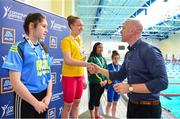 26 May 2018; Cora Rooney, from Ballyshannon, Co. Donegal, second from left, is presented with her second swimming gold medal by Aldi Ambassador Paul O'Connell during the Aldi Community Games May Festival, which saw over 3,500 children take part in a fun-filled weekend at University of Limerick from 26th to 27th May. Photo by Sam Barnes/Sportsfile