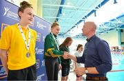26 May 2018; Ava Gannon, from Spa-Fenit - Barrow, Co. Kerry, second from left, is presented with a swimming gold medal by Aldi Ambassador Paul O'Connell during the Aldi Community Games May Festival, which saw over 3,500 children take part in a fun-filled weekend at University of Limerick from 26th to 27th May. Photo by Sam Barnes/Sportsfile