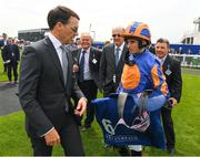 26 May 2018; Trainer Aidan O'Brien, left, and jockey Ryan Moore after winning The Irish Stallion Farms EBF Fillires Maiden Race on Winning Connections during the Curragh Races Irish 2000 Guineas Day at the Curragh in Kildare. Photo by Ray McManus/Sportsfile