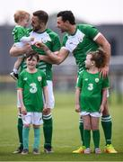26 May 2018; Patrick Maher, holding his daughter Amber, and his Ireland team-mate Sean Young, right, prior to the European Deaf Sport Organization European Championships third qualifying round match between Ireland and Sweden at the FAI National Training Centre in Abbotstown, Dublin. Photo by Stephen McCarthy/Sportsfile