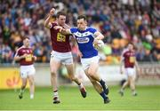26 May 2018; John O'Loughlin of Laois  in action against Darragh Daly of Westmeath during the Leinster GAA Football Senior Championship Quarter-Final match between Laois and Westmeath at Bord na Mona O'Connor Park in Tullamore, Offaly. Photo by Matt Browne/Sportsfile