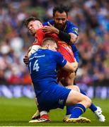 26 May 2018; Steff Evans of Scarlets is tackled by Jordan Larmour and Isa Nacewa of Leinster during the Guinness PRO14 Final between Leinster and Scarlets at the Aviva Stadium in Dublin. Photo by David Fitzgerald/Sportsfile