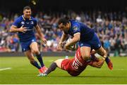 26 May 2018; James Lowe of Leinster is tackled by Leigh Halfpenny of Scarlets during the Guinness PRO14 Final between Leinster and Scarlets at the Aviva Stadium in Dublin. Photo by Ramsey Cardy/Sportsfile