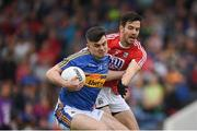 26 May 2018; Michael Quinlivan of Tipperary in action against Jamie O'Sullivan of Cork during the Munster GAA Football Senior Championship semi-final match between Tipperary and Cork at Semple Stadium in Thurles, County Tipperary. Photo by Eóin Noonan/Sportsfile