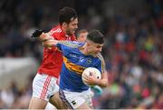 26 May 2018; Michael Quinlivan of Tipperary in action against Kevin Crowley of Cork during the Munster GAA Football Senior Championship semi-final match between Tipperary and Cork at Semple Stadium in Thurles, County Tipperary. Photo by Eóin Noonan/Sportsfile