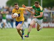 26 May 2018; Cathal Cregg of Roscommon in action against Alan Armstrong of Leitrim during the Connacht GAA Football Senior Championship semi-final match between Leitrim and Roscommon at Páirc Seán Mac Diarmada in Carrick-on-Shannon, Leitrim. Photo by Piaras Ó Mídheach/Sportsfile