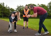 27 May 2018; Parkrun Ireland in partnership with Vhi, expanded their range of junior events to thirteen with the introduction of the Cobh junior parkrun on Sunday morning. Junior parkruns are 2km long and cater for 4 to 14 year olds, free of charge providing a fun and safe environment for children to enjoy exercise. Pictured is Kian Mullen, age 4, from Cobh, Cork, taking part in the parkrun with his mother April and father Robert. Photo by Eóin Noonan/Sportsfile