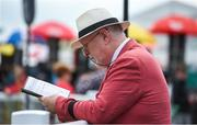 27 May 2018; Racegoer Jim Treacy from The Curragh, Co Kildare looks up the form ahead of the Curragh Races Irish 1000 Guineas Day at the Curragh in Kildare. Photo by Barry Cregg/Sportsfile
