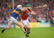 27 May 2018; Seamus Harnedy of Cork is tackled by Michael Cahill of Tipperary during the Munster GAA Hurling Senior Championship Round 2 match between Tipperary and Cork at Semple Stadium in Thurles, Tipperary. Photo by Eóin Noonan/Sportsfile