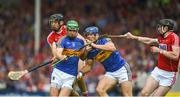 27 May 2018; Noel McGrath, left, and Jason Forde of Tipperary in action against Christopher Joyce, left, and Damien Cahalane of Cork during the Munster GAA Hurling Senior Championship Round 2 match between Tipperary and Cork at Semple Stadium in Thurles, Tipperary. Photo by Daire Brennan/Sportsfile