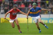 27 May 2018; Christopher Joyce of Cork in action against Noel McGrath of Tipperary during the Munster GAA Hurling Senior Championship Round 2 match between Tipperary and Cork at Semple Stadium in Thurles, Tipperary. Photo by Eóin Noonan/Sportsfile