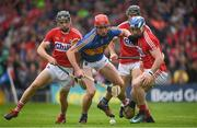 27 May 2018; Billy McCarthy of Tipperary in action against Mark Coleman, left and Sean O'Donoghue of Cork during the Munster GAA Hurling Senior Championship Round 2 match between Tipperary and Cork at Semple Stadium in Thurles, Tipperary. Photo by Eóin Noonan/Sportsfile