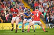 27 May 2018; Dan McCormack of Tipperary in action against Darragh Fitzgibbon, left, and Colm Spillane of Cork during the Munster GAA Hurling Senior Championship Round 2 match between Tipperary and Cork at Semple Stadium in Thurles, Tipperary. Photo by Eóin Noonan/Sportsfile
