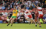 27 May 2018; Michael Murphy of Donegal  in action against Michael Bateson of Derry during the Ulster GAA Football Senior Championship Quarter-Final match between Derry and Donegal at Celtic Park in Derry. Photo by Oliver McVeigh/Sportsfile