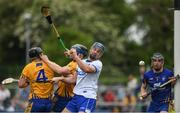 27 May 2018; Michael Walsh of Waterford in action against Jack Browne, left, David McInerney and Donal Tuohy of Clare during the Munster GAA Hurling Senior Championship Round 2 match between Clare and Waterford at Cusack Park in Ennis, Co Clare. Photo by Ray McManus/Sportsfile