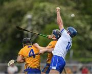 27 May 2018; Michael Walsh of Waterford in action against Jack Browne, left, David McInerney of Clare during the Munster GAA Hurling Senior Championship Round 2 match between Clare and Waterford at Cusack Park in Ennis, Co Clare. Photo by Ray McManus/Sportsfile