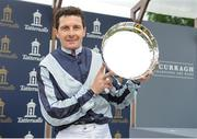 27 May 2018; Jockey Colm O'Donoghue holds up the winning trophy after he rode Alpha Centauri to win the Tattersalls Irish 1,000 Guineas during the Curragh Races Irish 1000 Guineas Day at the Curragh in Kildare. Photo by Barry Cregg/Sportsfile