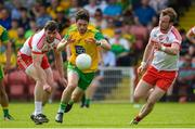 27 May 2018; Ryan McHugh of Donegal in action against Mark Lynch and Padraig Cassidy of Derry during the Ulster GAA Football Senior Championship Quarter-Final match between Derry and Donegal at Celtic Park in Derry. Photo by Oliver McVeigh/Sportsfile