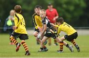 26 May 2018; Oscar Monks of Kilcullen, Co. Kildare, is tackled by John Paul Flanagan, left, and Brian McCabe of Rosses Point, Co. Sligo during the Mini Rugby event. Over 3,500 children took part in Aldi Community Games May Festival on a sun-drenched, fun-filled weekend in University of Limerick from 26th to 27th May. Photo by Diarmuid Greene/Sportsfile