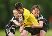26 May 2018; Marc Clifford of Rosses Point, Co. Sligo, in action against Oscar Monks, left, and Jamie Bohan of Kilcullen, Co. Kildare, during the Mini Rugby event. Over 3,500 children took part in Aldi Community Games May Festival on a sun-drenched, fun-filled weekend in University of Limerick from 26th to 27th May. Photo by Diarmuid Greene/Sportsfile