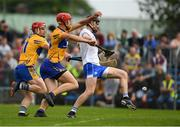 27 May 2018; Waterford full back Barry Coughlan kicks the sliorhar out for a '65', under pressure from Peter Duggan and John Conlon of Clare, 11, during the Munster GAA Hurling Senior Championship Round 2 match between Clare and Waterford at Cusack Park in Ennis, Co Clare. Photo by Ray McManus/Sportsfile