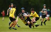 26 May 2018; Rhys Byrne of Kilcullen, Co. Kildare, is tackled by Marc Clifford, left, and Finnán O'Mahony of Rosses Point, Co. Sligo during the Mini Rugby event. Over 3,500 children took part in Aldi Community Games May Festival on a sun-drenched, fun-filled weekend in University of Limerick from 26th to 27th May. Photo by Diarmuid Greene/Sportsfile