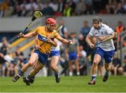27 May 2018; John Conlon of Clareis tackled by Colm Roche of Waterford, with Philip Mahony to the right, during the Munster GAA Hurling Senior Championship Round 2 match between Clare and Waterford at Cusack Park in Ennis, Co Clare. Photo by Ray McManus/Sportsfile