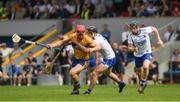 27 May 2018; John Conlon of Clareis tackled by Colm Roche of Waterford, with Philip Mahony,to the right, during the Munster GAA Hurling Senior Championship Round 2 match between Clare and Waterford at Cusack Park in Ennis, Co Clare. Photo by Ray McManus/Sportsfile