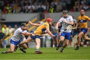27 May 2018; John Conlon of Clare is tackled by Colm Roche of Waterford, with Philip Mahony, 7, to the right, during the Munster GAA Hurling Senior Championship Round 2 match between Clare and Waterford at Cusack Park in Ennis, Co Clare. Photo by Ray McManus/Sportsfile