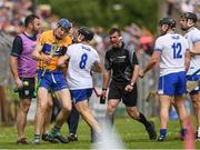 27 May 2018; Referee Paud O'Dwyer calls for order as Jamie Barron of Waterford and David Fitzgerald of Clare jostle during the Munster GAA Hurling Senior Championship Round 2 match between Clare and Waterford at Cusack Park in Ennis, Co Clare. Photo by Ray McManus/Sportsfile