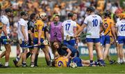 27 May 2018; Tony Kelly of Clare, 9, lies injured and Kevin Moran of Waterford, who was later shown a red card, looks on during the Munster GAA Hurling Senior Championship Round 2 match between Clare and Waterford at Cusack Park in Ennis, Co Clare. Photo by Ray McManus/Sportsfile