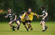 26 May 2018; John Paul Flanagan of Rosses Point, Co. Sligo, is tackled by Archie Galvin and Turlough Donnelly of Kilcullen, Co. Kildare, during the Mini Rugby event. Over 3,500 children took part in Aldi Community Games May Festival on a sun-drenched, fun-filled weekend in University of Limerick from 26th to 27th May. Photo by Diarmuid Greene/Sportsfile