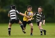 26 May 2018; John Paul Flanagan of Rosses Point, Co. Sligo, is tackled by Archie Galvin and Jack Fogarty of Kilcullen, Co. Kildare, during the Mini Rugby event. Over 3,500 children took part in Aldi Community Games May Festival on a sun-drenched, fun-filled weekend in University of Limerick from 26th to 27th May. Photo by Diarmuid Greene/Sportsfile