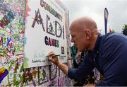 26 May 2018; Aldi ambassador Paul O'Connell signs the Aldi Doodle wall during day 1 of the Aldi Community Games. Over 3,500 children took part in Aldi Community Games May Festival on a sun-drenched, fun-filled weekend in University of Limerick from 26th to 27th May. Photo by Diarmuid Greene/Sportsfile