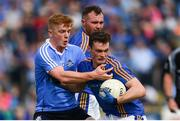 27 May 2018; Cathal Magee of Wicklow is tackled by Conor McHugh of Dublin during the Leinster GAA Football Senior Championship Quarter-Final match between Wicklow and Dublin at O'Moore Park in Portlaoise, Co Laois. Photo by Ramsey Cardy/Sportsfile