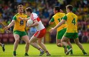 27 May 2018; Emmet Bradley of Derry in action against Leo McLoone, Frank McGlynn and Eoghan Bán Gallagher of Donegal during the Ulster GAA Football Senior Championship Quarter-Final match between Derry and Donegal at Celtic Park in Derry. Photo by Oliver McVeigh/Sportsfile