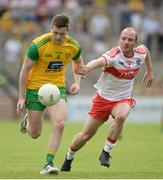 27 May 2018; Eoghan Bán Gallagher of Donegal in action against Sean Leo McGoldrick of Derry during the Ulster GAA Football Senior Championship Quarter-Final match between Derry and Donegal at Celtic Park in Derry. Photo by Oliver McVeigh/Sportsfile
