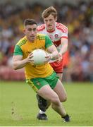 27 May 2018; Patrick McBrearty of Donegal in action against Brendan Rogers of Derry during the Ulster GAA Football Senior Championship Quarter-Final match between Derry and Donegal at Celtic Park in Derry. Photo by Oliver McVeigh/Sportsfile