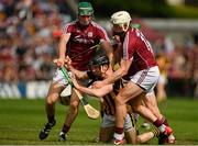 27 May 2018; Conor Delaney of Kilkenny is tackled by Galway's, from left, Cathal Mannion, Conor Whelan, and Joe Canning during the Leinster GAA Hurling Senior Championship Round 3 match between Galway and Kilkenny at Pearse Stadium in Galway. Photo by Piaras Ó Mídheach/Sportsfile