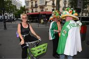28 May 2018; Republic of Ireland supporters Bobby Cunningham, from Kilcar, left, with Frankie Murrin, from Killybegs, right, watches as a Parisian passes on her bike in Paris prior to the International Friendly match between France and Republic of Ireland at Stade de France in Paris, France. Photo by Stephen McCarthy/Sportsfile