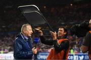 28 May 2018; RTE's Tony O'Donoghue is sheltered from the rain during a broadcast prior to the International Friendly match between France and Republic of Ireland at Stade de France in Paris, France. Photo by Stephen McCarthy/Sportsfile