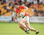 27 May 2018; Ciaran Moran of Carlow in action against Eanna O'Connor of Kildare during the Leinster GAA Football Senior Championship Quarter-Final match between Carlow and Kildare at O'Connor Park in Tullamore, Offaly. Photo by Matt Browne/Sportsfile