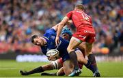 26 May 2018; Cian Healy of Leinster is tackled by Tadhg Beirne, behind, and Hadleigh Parkes of Scarlets during the Guinness PRO14 Final between Leinster and Scarlets at the Aviva Stadium in Dublin. Photo by Ramsey Cardy/Sportsfile