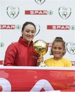 30 May 2018; The SPAR FAI Primary School 5s National Finals took place in the Aviva Stadium on Wednesday, May 30th, where former Republic of Ireland International Keith Andrews and current Republic of Ireland women's footballer Megan Campbell were in attendance supporting as girls and boys from 13 counties battled it out for national honours. Pictured is Jodie Loughrey of Scoil Íosagáin, Buncrana, Inishowen, Co. Donegal, with her Player of the Tournament Award and Republic of Ireland women's footballer Megan Campbell during the SPAR FAI Primary School 5s National Finals at Aviva Stadium in Dublin. Photo by Harry Murphy/Sportsfile