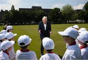 """31 May 2018; Ronnie Delany was guest of honour at his alma mater, CUS Sports Day at College Park, Trinity College. CUS Junior School on Leeson Street is celebrating 150 years of the school. Teachers and children also joined to celebrate the 62nd anniversary of when Ronnie Delany became the first Irish man to break 4 minutes for the mile in Compton, USA, running 3:59.0 on June 1st, 1956, the same year he won gold over 1500m at the Olympic Games in Melbourne. Ronnie Delany is pictured addressing participants during The Ronnie Delany """"Smile Run"""", at College Park, Trinity College, Dublin. Photo by David Fitzgerald/Sportsfile"""